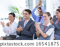 Business team applauding during conference 16541875
