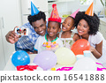 Happy family celebrating a birthday together 16541888