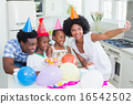 Happy family celebrating a birthday together 16542502