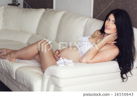 239b99f014d Sexy pregnant woman is wearing white lingerie at home - Stock Photo ...