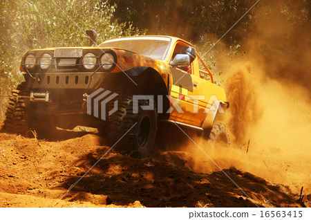 Stock Photo: Racer at terrain racing car competition