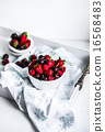 Mix of berries on white rustic background 16568483