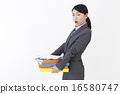 A woman with lots of papers 16580747
