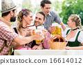 Friends in Bavarian beer garden drinking in summer 16614012