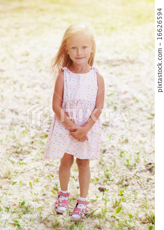 happy girl stand on meadow with poplar wool stock photo 16626594