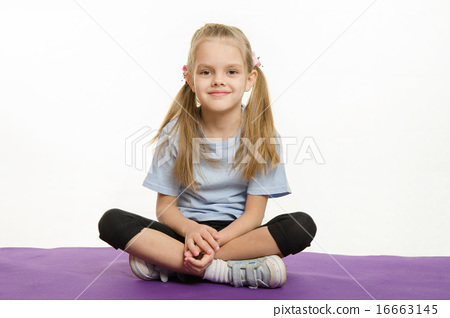 Six year old girl athlete sitting on a rug 16663145