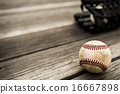Baseball and mitt on rustic wooden background 16667898