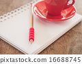Red mug with open notebook 16688745