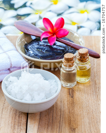 Stock Photo: Spa and wellness treatment setup on wooden panel.