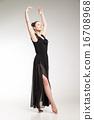 Young ballet dancer wearing black transparent dress dancing  16708968