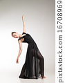 Young ballet dancer wearing black transparent dress dancing  16708969