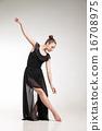 Young ballet dancer wearing black transparent dress dancing  16708975