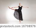 Young ballet dancer wearing black transparent dress dancing  16708976