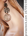 Beautiful woman with earrings. Jewelry and Beauty 16709198