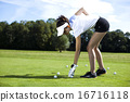 Woman playing golf on field, bright colorful  16716118