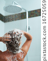 Woman applying shampoo in shower. Rear view 16725059