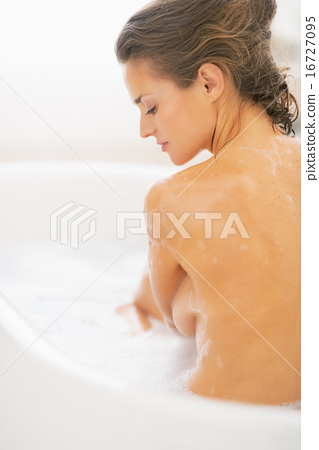 Relaxed young woman sitting in bathtub 16727095