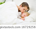 Mother kissing sleeping baby 16729256