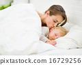Mother kissing sleeping baby 16729256