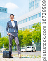 Full length portrait of happy business woman with briefcase in o 16729509