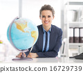 Portrait of happy business woman holding earth globe 16729739