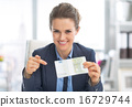 Happy business woman pointing on money pack 16729744