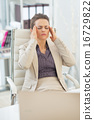 Portrait of business woman with head ache in office 16729822