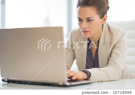 Business woman working on laptop in office 16729999