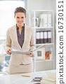 Portrait of happy business woman working in office 16730151