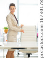 Smiling business woman offering to sit 16730178