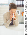 Business woman in office blowing nose 16730207