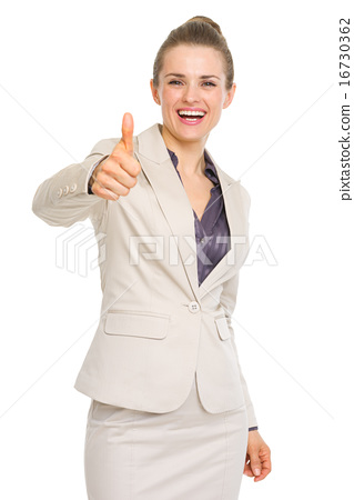 Happy business woman showing thumbs up 16730362