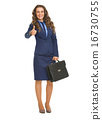 Full length portrait of smiling business woman with briefcase sh 16730755