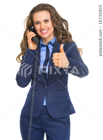 Happy business woman talking phone and showing thumbs up 16730903