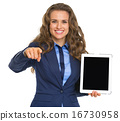 Business woman holding tablet pc with blank screen and pointing 16730958
