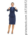 Full length portrait of business woman showing thumbs up 16730972