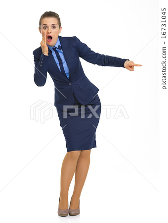 Full length portrait of shocked business woman pointing on copy 16731045