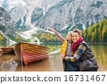 Mother and daughter on Lake Bries shores with wooden boat 16731467
