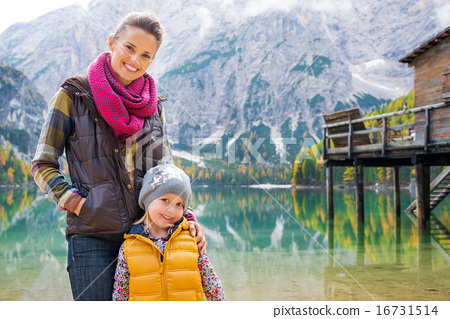 Smiling mother and blonde daughter posing at Lake Bries 16731514