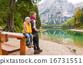 Portrait of mother and baby on lake braies in south tyrol, italy 16731551