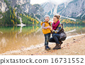 Smiling mother and daughter on the shore of Lake Bries 16731552