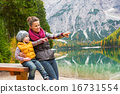 Portrait of happy mother and baby on lake braies in south tyrol, 16731554