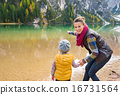 Mother and daughter playing on the shore of Lake Bries 16731564