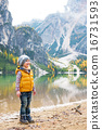 Full length portrait of child on lake braies in south tyrol, ita 16731593
