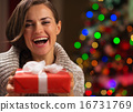 Portrait of happy woman with Christmas present box 16731769