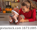 Happy mother and baby looking photos in camera 16731885