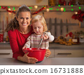 Baby helping mother make christmas cookies 16731888