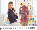 Portrait of fashion designer in office 16734093