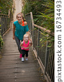 Healthy mother and baby girl walking on stairs 16734493