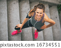 Portrait of smiling fitness young woman outdoors in the city 16734551